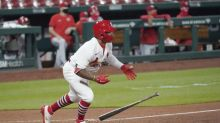 Cards finally back home, rally for 3 in 9th to beat Reds 5-4