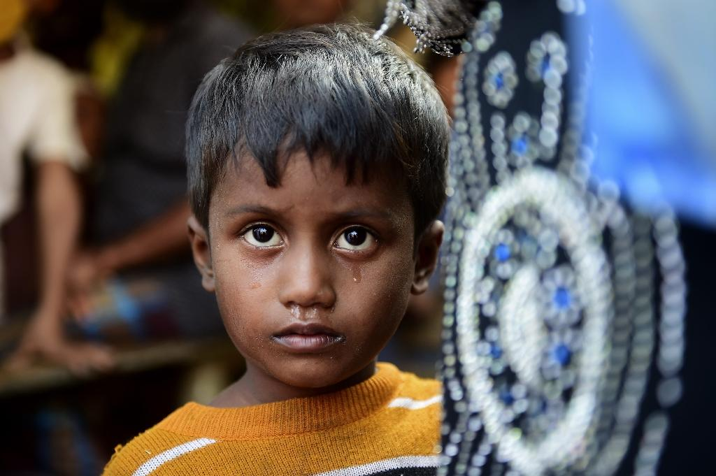 Tens of thousands of Rohingya have fled from Myanmar to Bangladesh (AFP Photo/MUNIR UZ ZAMAN)