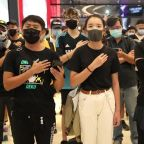 Hand on heart: Hong Kongers sing protest anthem in Yuen Long mall