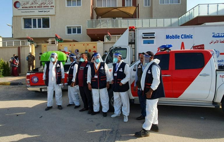 Libyan medical workers prepare for an awareness campaign on Covid-19 at Friday market shops in the capital Tripoli