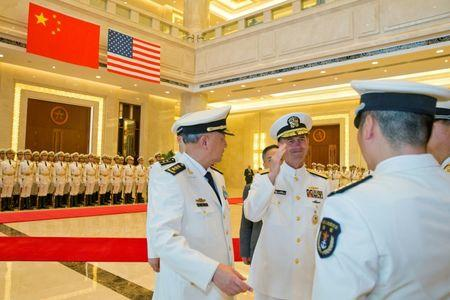 Commander of the Chinese navy, Admiral Wu Shengli (L) introduces his officers to U.S. Chief of Naval Operations Admiral John Richardson (2nd, L) during a welcome ceremony held at the Chinese Navy Headquarters in Beijing, China, July 18, 2016. REUTERS/Ng Han Guan/Pool