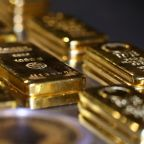 Gold falls as yields firm up ahead of U.S. inflation data