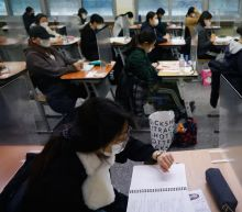 The Latest: Young S. Koreans taking crucial university exam