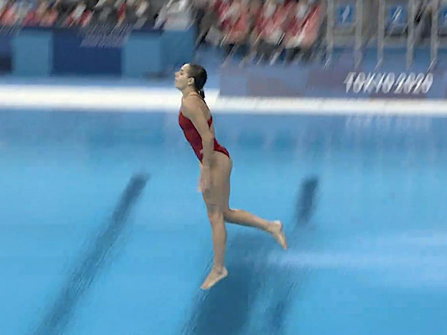A Canadian diver who scored a 0 with a feet-first flop with the finals on the line said she wasn't going to give up