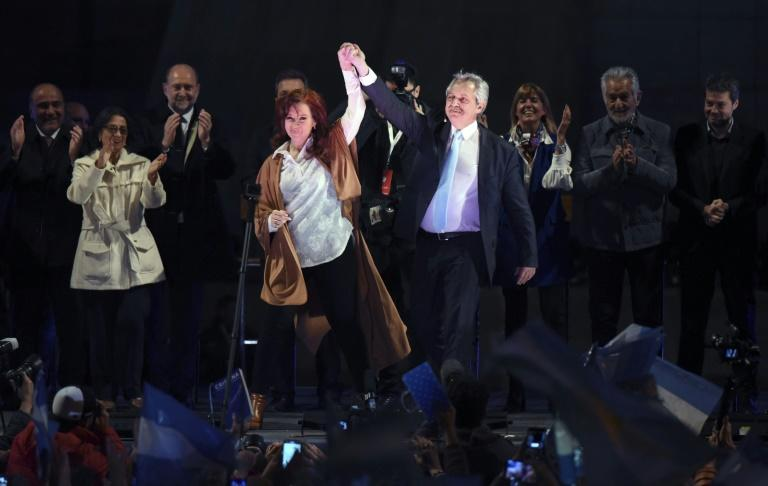 Peronist Alberto Fernandez (right) stormed to a clear victory over President Mauricio Macri in Sunday's party primaries and is now favored to win October's election (AFP Photo/HO)