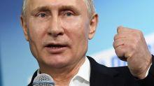 Putin cruises to landslide election win