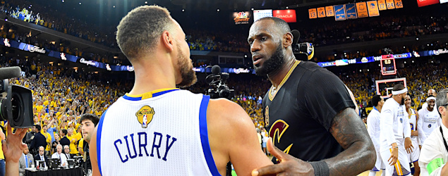 Stephen Curry of the Golden State Warriors and LeBron James of the Cleveland Cavaliers. (Jesse D. Garrabrant/NBAE/Getty Images)