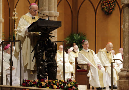 Archbishop Carlo Maria Vigano reads the Apostolic Mandate during the Installation Mass of Archbishop Blase Cupich at Holy Name Cathedral in Chicago