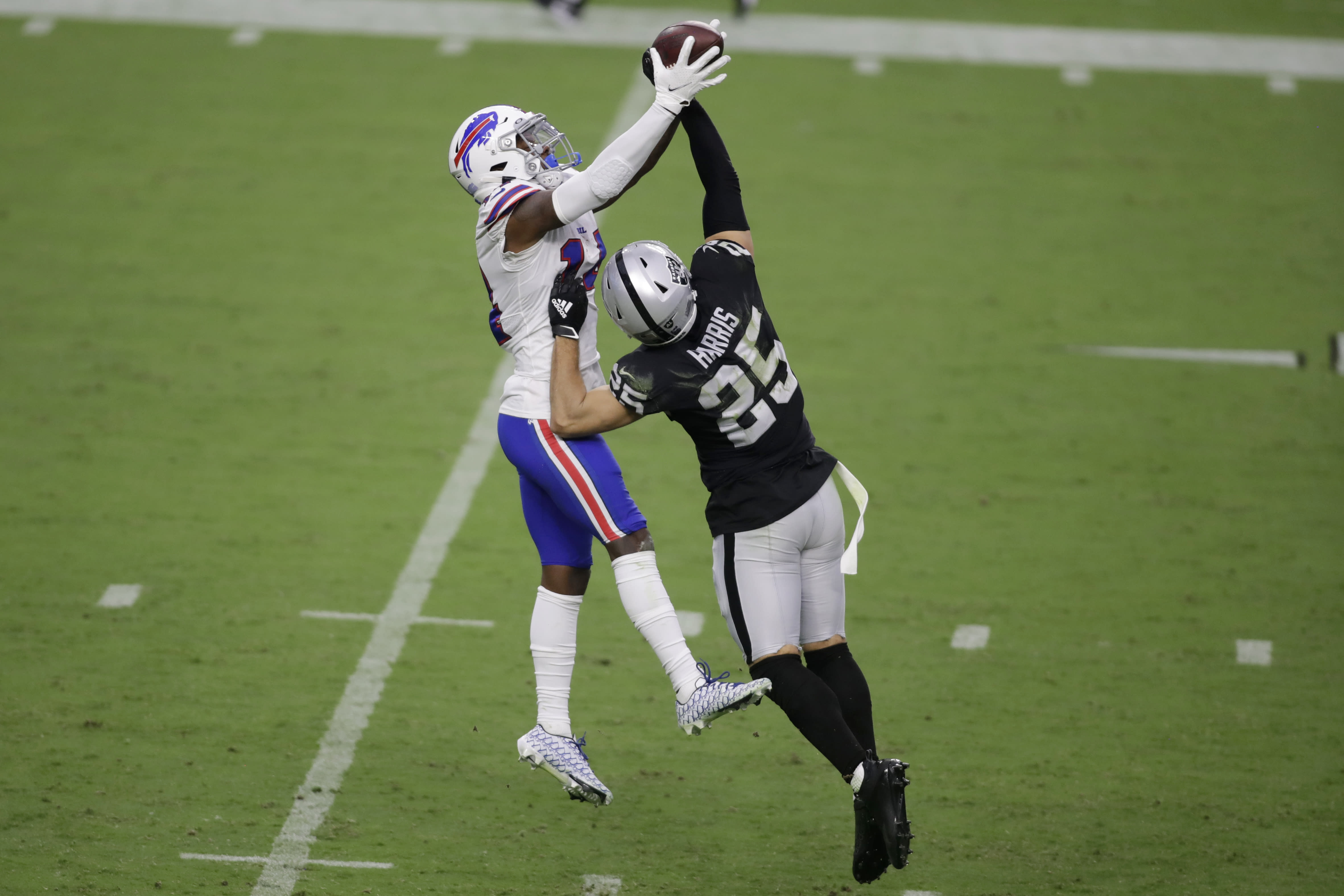 Buffalo Bills wide receiver Stefon Diggs (14) catches a pass over Las Vegas Raiders free safety Erik Harris (25) during the second half of an NFL football game, Sunday, Oct. 4, 2020, in Las Vegas. (AP Photo/Isaac Brekken)
