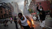 Police cars burn, windows shatter as protests roil New York