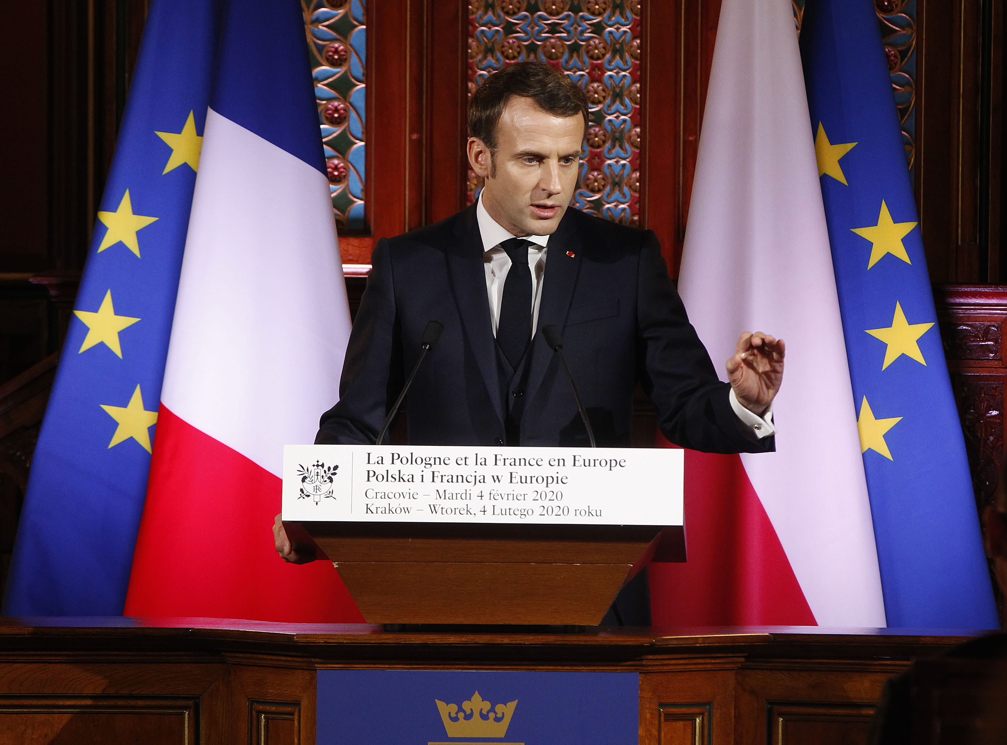 French President Emmanuel Macron delivers a speech to students and intellectuals at the Jagiellonian University for a lecture on the future of a united Europe in Krakow, Poland, Tuesday, Feb. 4, 2020.(AP Photo/Czarek Sokolowski)