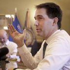 Wisconsin's Walker signs sweeping lame-duck GOP bills
