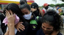 In Ecuador, families finally recover bodies lost in virus chaos
