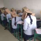 Photo of college students taking exam with boxes on their heads sparks controversy
