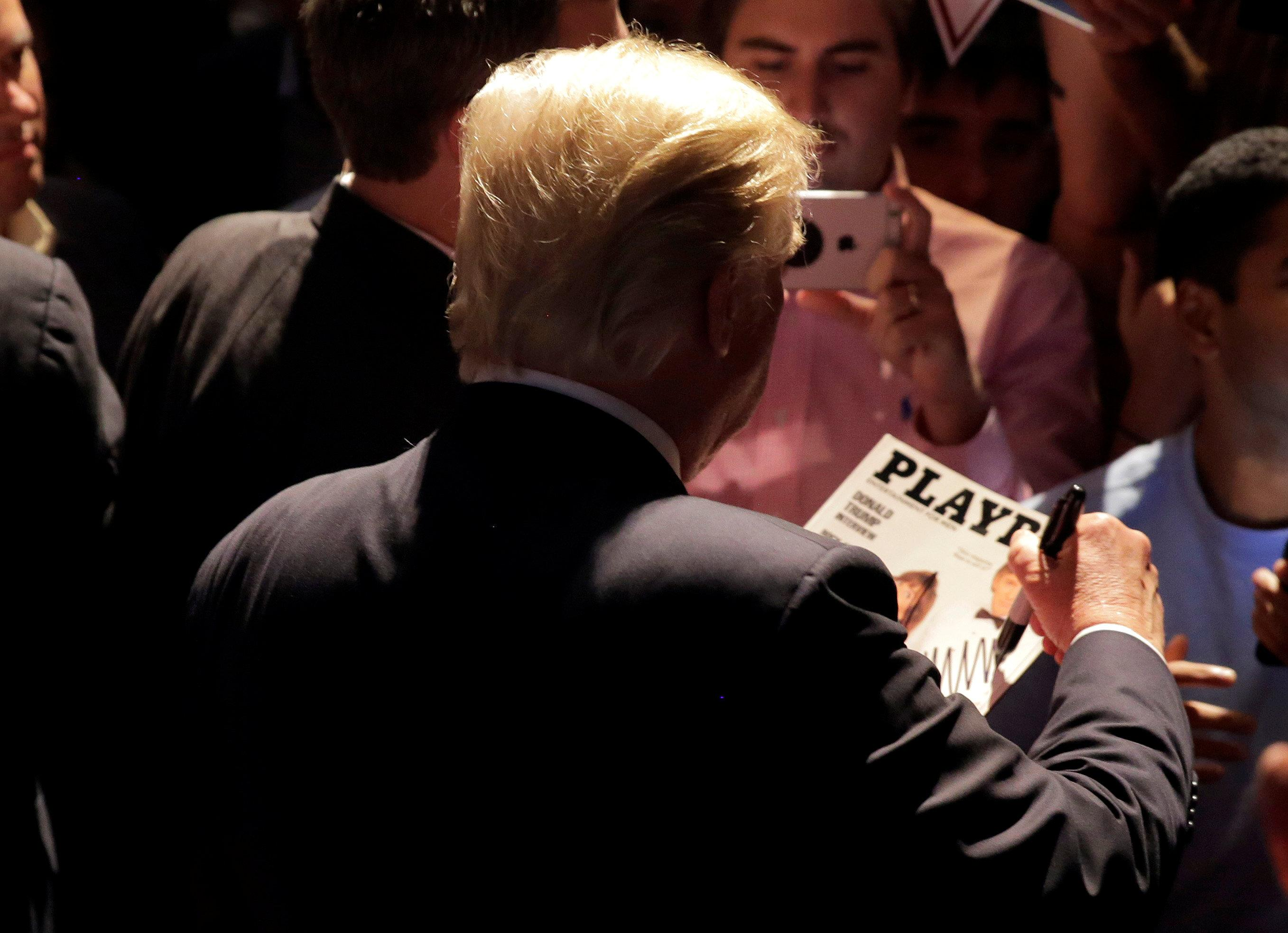 <p>Republican presidential candidate Donald Trump signs a copy of <em>Playboy</em> magazine at a campaign rally in Raleigh, N.C., July 5, 2016. (Photo: Joshua Roberts/Reuters) </p>