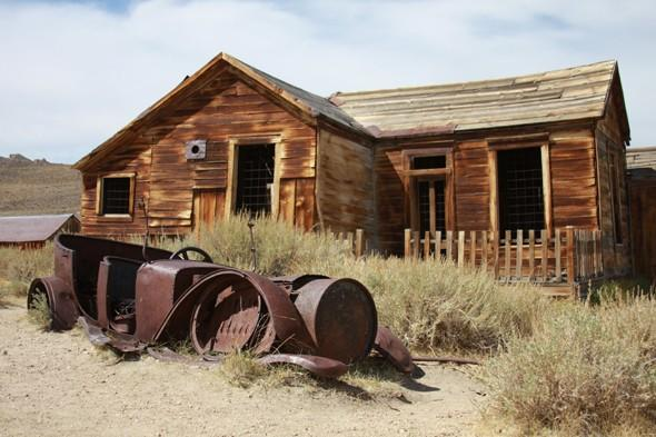 <p> 	Around 75 miles south east of Lake Tahoe lies the abandoned town of Bodie, which was originally a mining town founded for its discovery of gold in 1859. Its profitable discovery made Bodie a Wild West Boom town in 1876 and it produced nearly $34 million worth of gold. The population grew to up to 7,000 by 1879 but by 1880 Bodie started to decline as people moved on to other boomtowns. Today it attracts thousands of tourists every year to see its deserted streets and peer in the windows of the remaining buildings.</p>