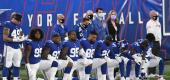 Members of the New York Giants kneel before a game. (Getty Images)