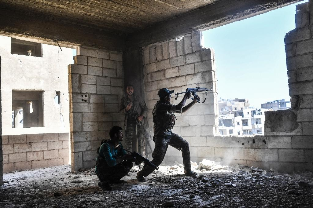 Members of the Syrian Democratic Forces battle Islamic State group jihadists in Raqa, Syria