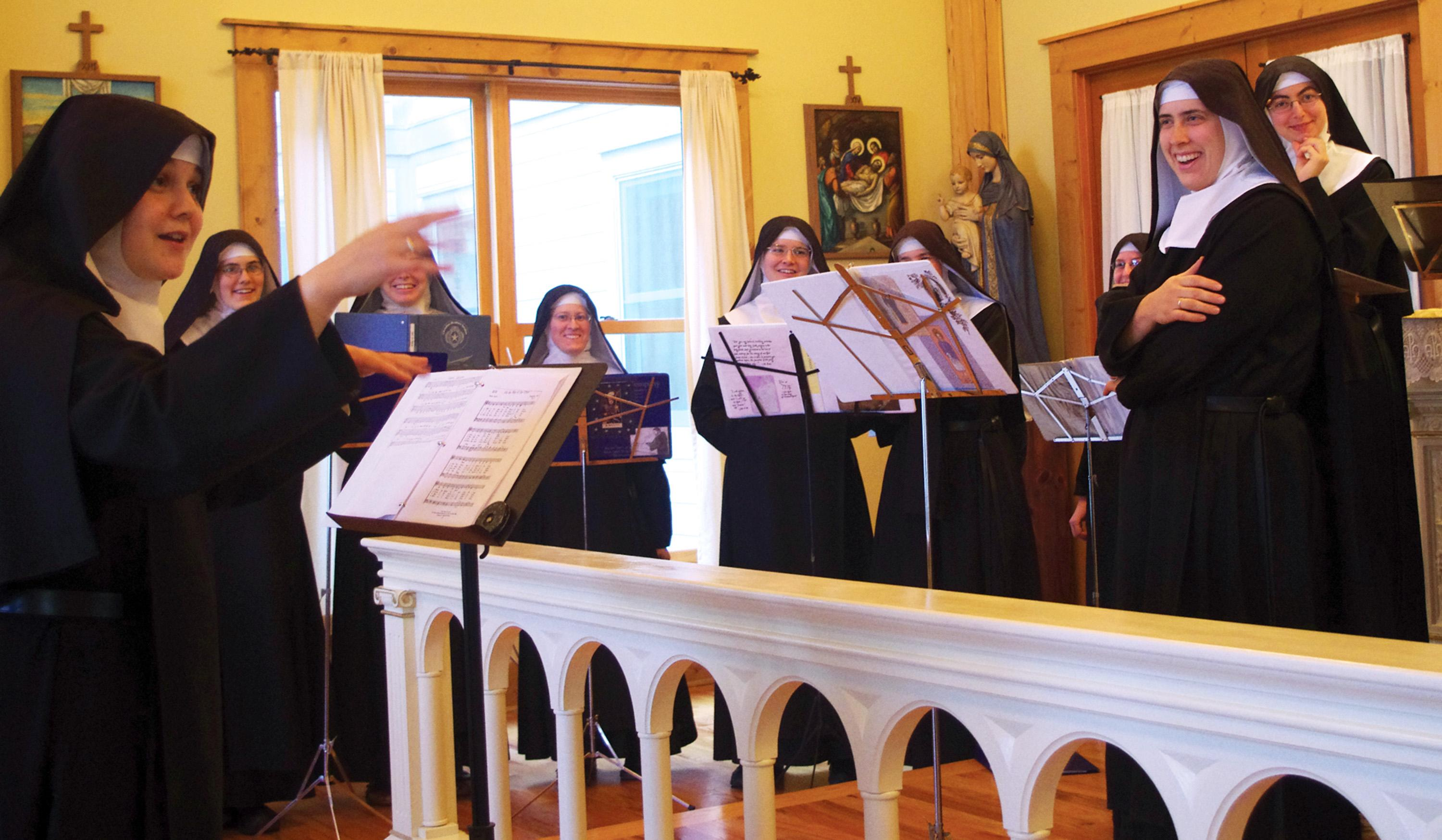 """In this Nov. 18, 2013 photo provided by De Montfort Music, Mother Cecilia, left, conducts the Sisters during the recording sessions for """"Lent at Ephesus"""" in the chapel at the Priory of The Benedictines of Mary called """"Ephesus"""" near Gower, Mo. The Benedictines of Mary were named Billboard's Top Traditional Classical Album Artist of 2013, for the second year in a row. Their new album, """"Lent At Ephesus,"""" was released Feb. 11 on the Decca/De Montfort Music label. (AP Photo/Courtesy De Montfort Music)"""