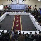 Afghan president wins vote, opponent says he's the winner