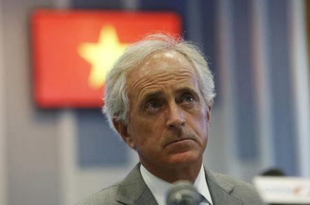 U.S. Senator Bob Corker of Tennessee listens to questions from journalists during a news briefing in Hanoi