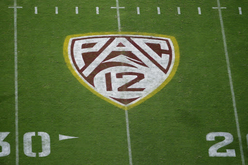 FILE - This Aug. 29, 2019, file photo shows the Pac-12 logo at Sun Devil Stadium during the second half of an NCAA college football game between Arizona State and Kent State in Tempe, Ariz. The Pac-12 has become the second major conference to shift to a conference-only fall schedule amid growing concerns over the coronavirus pandemic. (AP Photo/Ralph Freso, File)