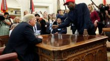 Kanye West defends support for Trump, in front of Trump