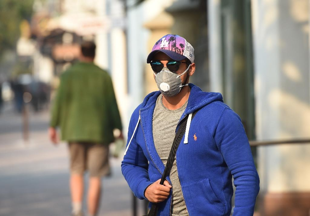 Winds will blow at up to 65 km per hour (40 miles per hour), forecasters said, as public health authorities urged people to wear face masks to protect against ash and smoke from California's raging wildfires (AFP Photo/Robyn Beck)