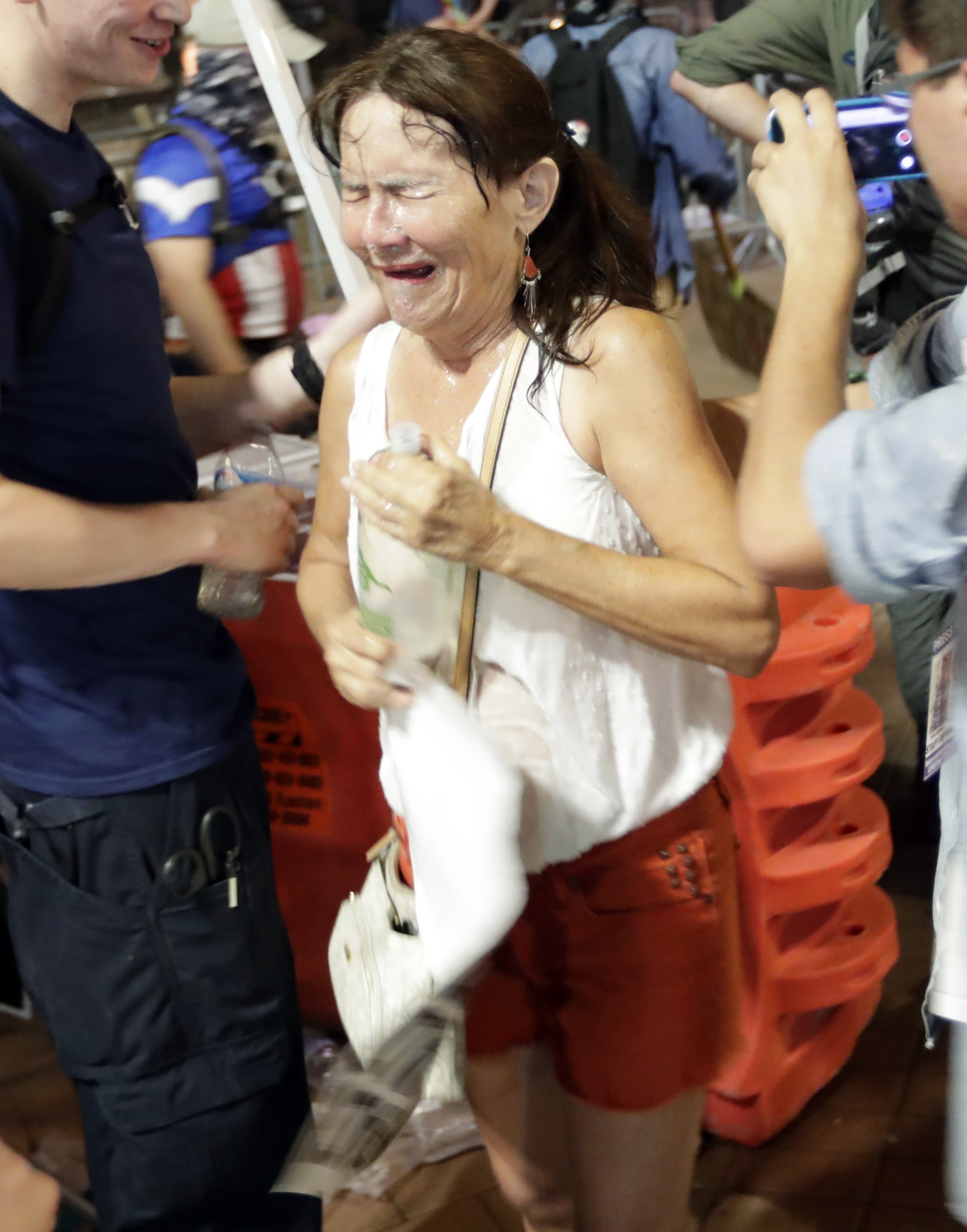 <p>Protesters leave the scene after Phoenix police used pepper spray outside the Phoenix Convention Center, Tuesday, Aug. 22, 2017, in Phoenix. Protests were held against President Donald Trump as he hosted a rally inside the convention center. (AP Photo/Matt York) </p>