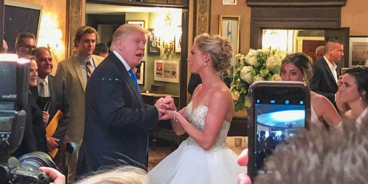 Trump clasped hands with the bride. (Photo: @lauramp11 via Twitter)