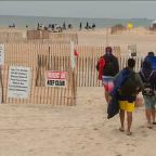 Crowds smaller, beachgoers practicing social distancing
