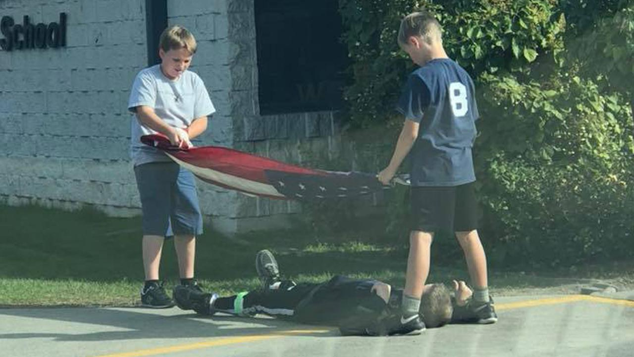Photo of 5th-Grade Boys Carefully Folding Flag Goes Viral for its Patriotism