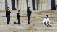 Major Australian city in virus 'limbo' as outbreak rages