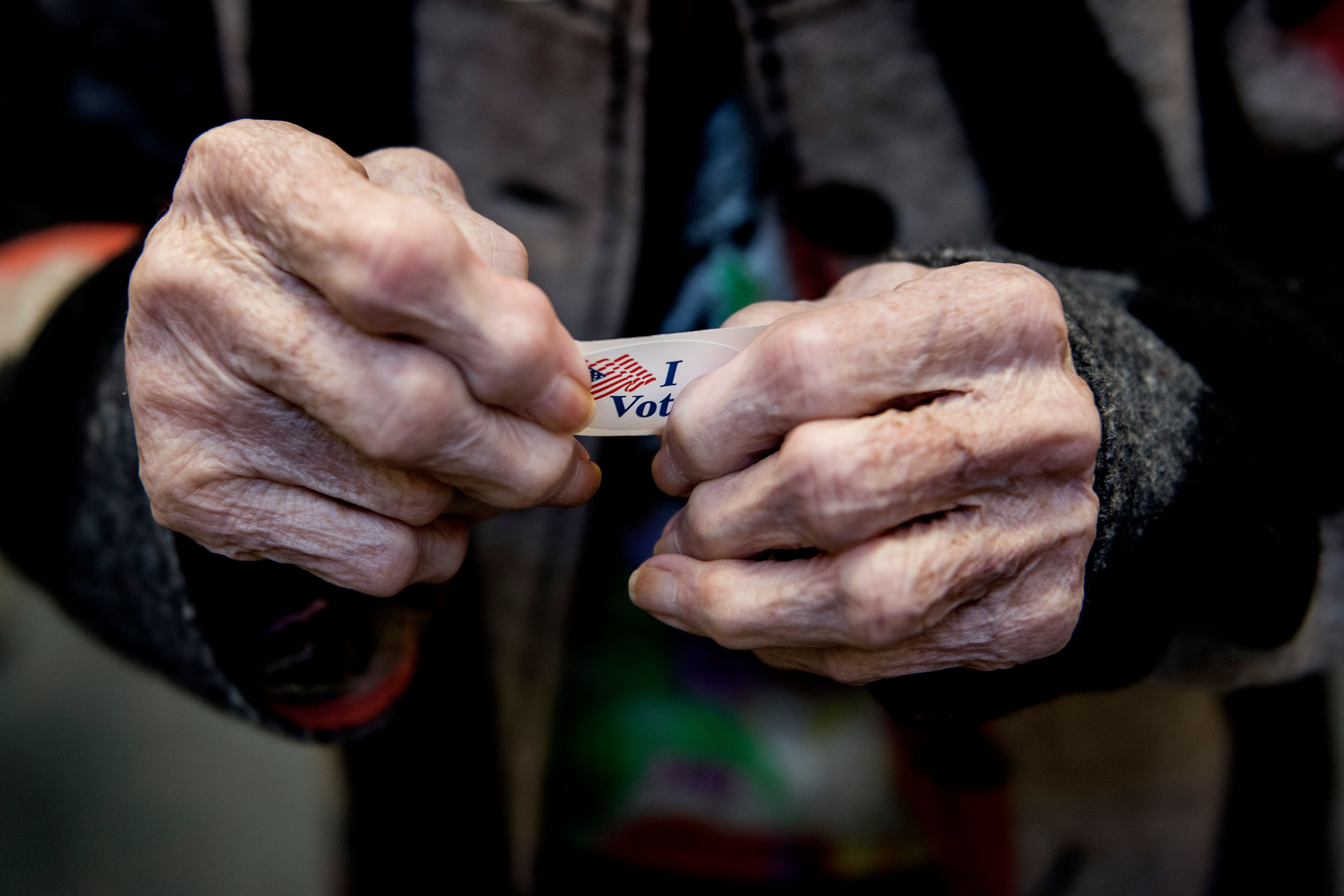 """<p>Iva Woke, a 100-year-old resident living in Chestertown, Md., holds her """"I voted"""" sticker after casting her ballot at the Kent County Public Library in Chestertown during Maryland's early voting on Oct. 5, 2018. (Photo by Jim WAatson/AFP/Getty Images) </p>"""