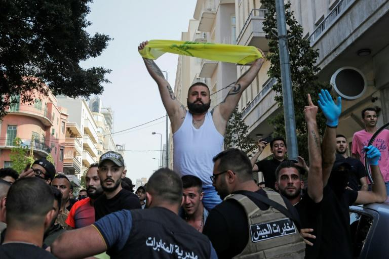 At one point, soldiers had to step in to form a human chain separating the two sides after supporters and opponents of Hebzollah threw stones at each other (AFP Photo/ANWAR AMRO)