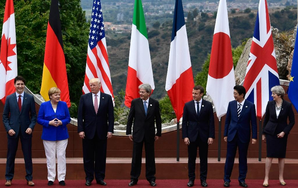 The leaders of Britain, Canada, France, Germany, Japan, the US and Italy pose during the G7 summit in Sicily (AFP Photo/Miguel MEDINA)