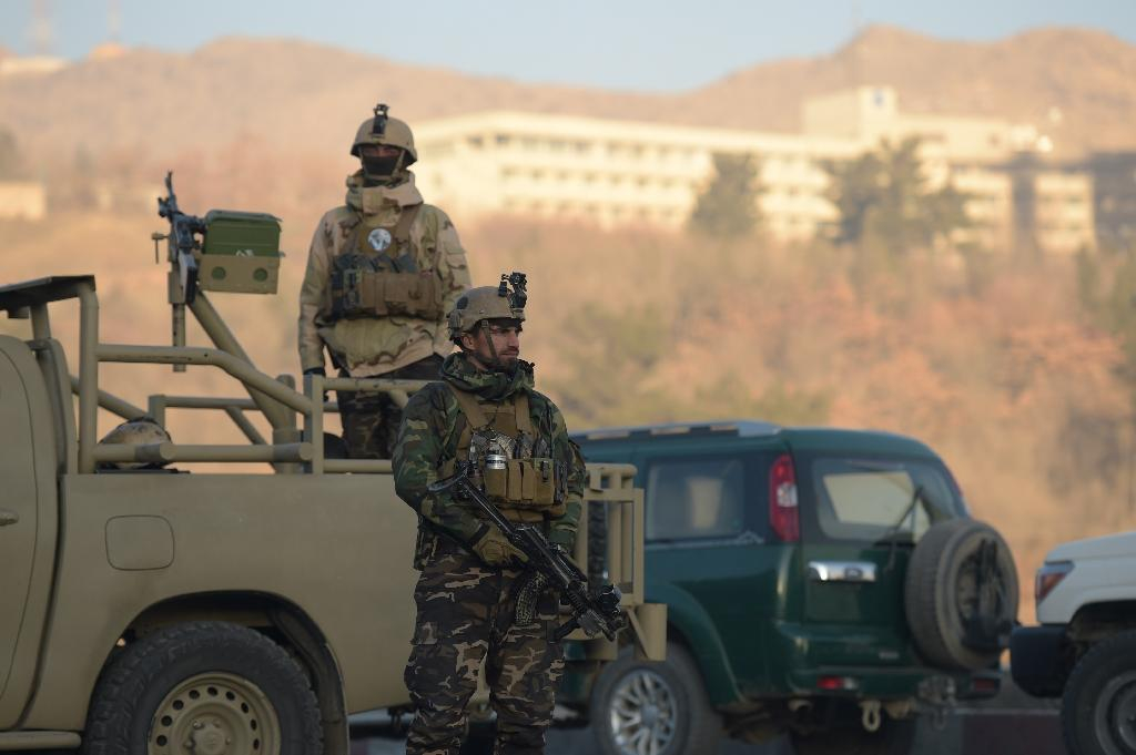 At least five people have died in an attack on Kabul's Intercontinental Hotel when gunmen began firing at guests and staff (AFP Photo/SHAH MARAI)