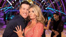 Strictly's Anton pops out of Susannah's dress