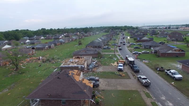 Damaged buildings are seen in the aftermath of a tornado in Monroe
