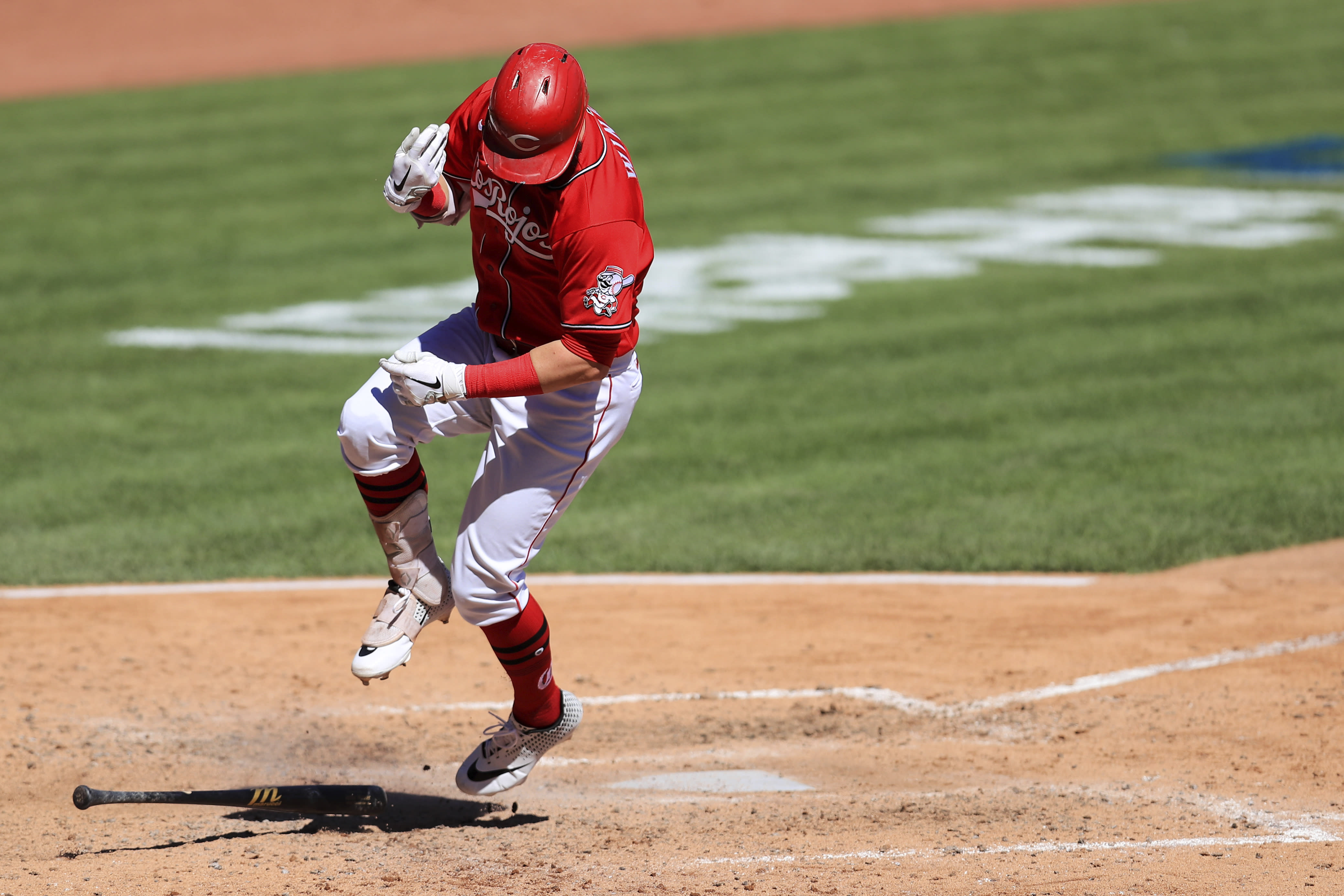 Cincinnati Reds' Jesse Winker reacts to being hit on the hand by a pitch from Chicago White Sox' Ross Detwiler in the fourth inning during a baseball in Cincinnati, Sunday, Sept. 20, 2020. (AP Photo/Aaron Doster)