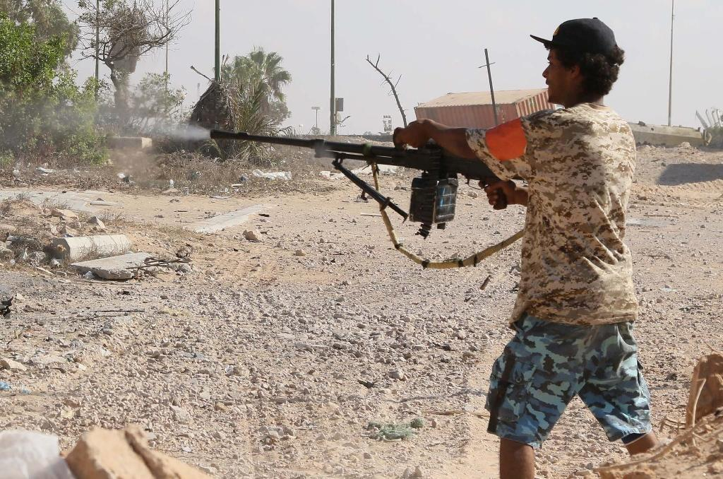 A Libyan pro-regime fighter with the Government of National Accord (GNA) fires at Islamic State jihadists during clashes for control of Sirte, on September 3, 2016