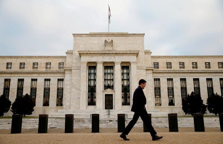 A man walks past the Federal Reserve Bank in Washington DC