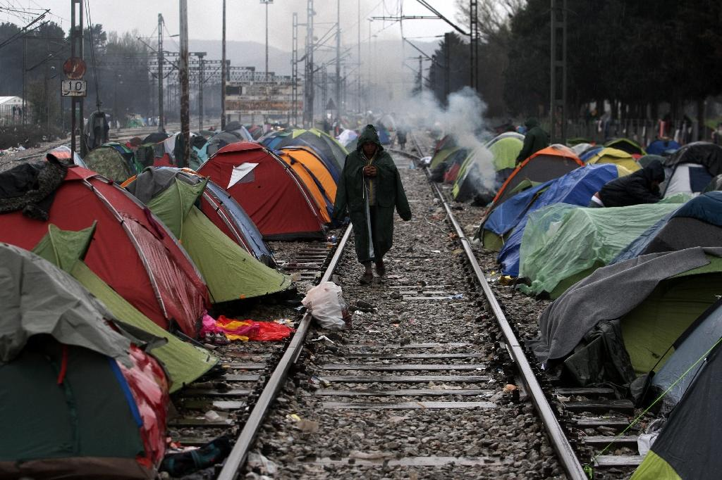 A man walks along railway tracks at the Greek-Macedonian border near the Greek village of Idomeni, on March 9, 2016, where thousands of refugees and migrants are trapped (AFP Photo/Sakis Mitrolidis)