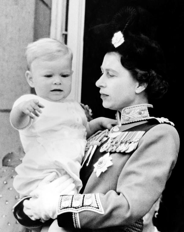 Queen Elizabeth II with Andrew, her third child, on the balcony of Buckingham Palace in 1961. (AFP Photo/STRINGER)