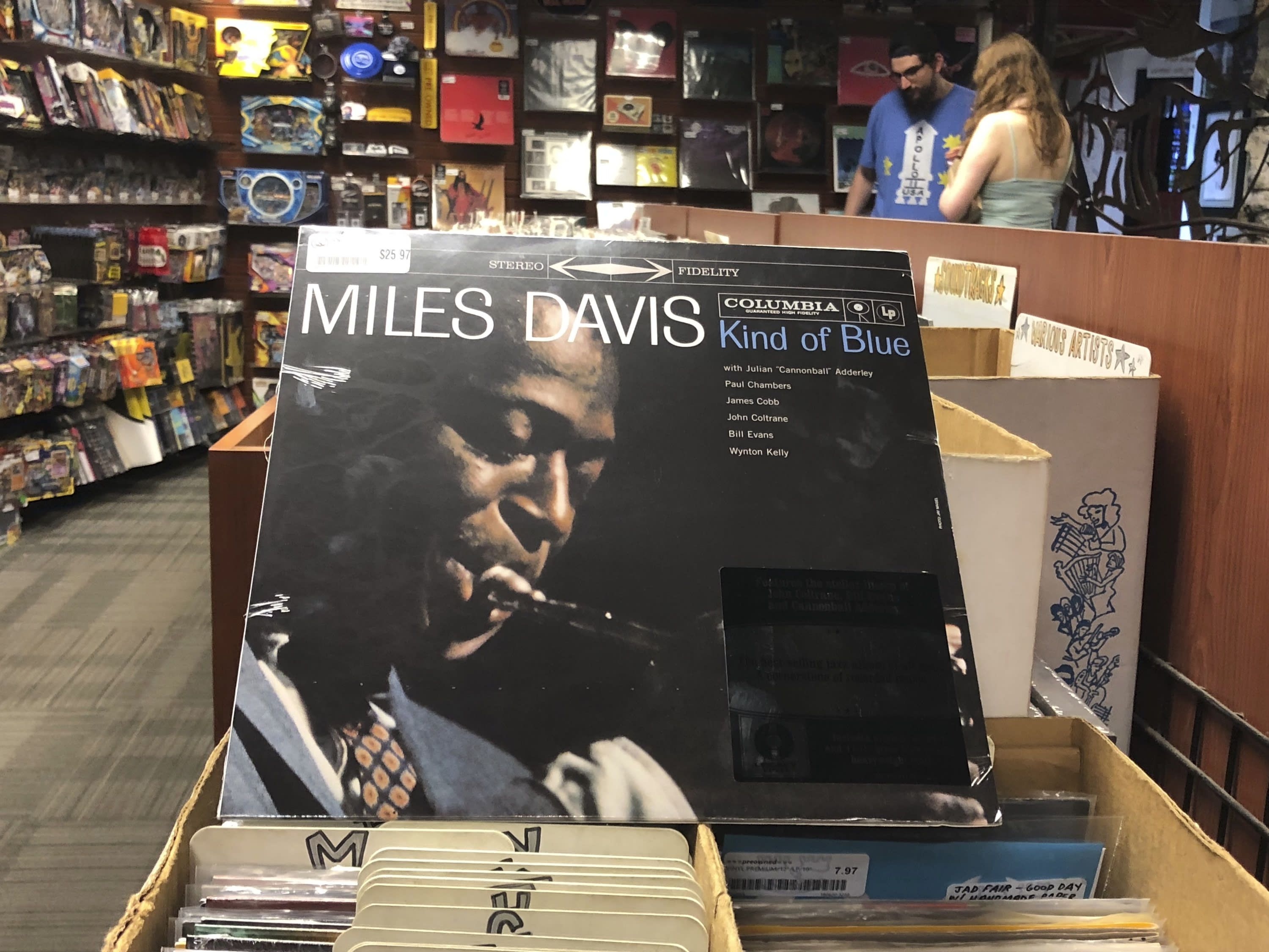 """FILE - In this Aug. 17, 2019, file photo, the """"Kind of Blue"""" album cover is on display at Bull Moose record store in Portland, Maine, on the 60th anniversary of the album's release. Drummer Jimmy Cobb, the last surviving musician who performed on Miles Davis' jazz masterpiece """"Kind of Blue,"""" died Sunday, May 25, 2020, at his Manhattan home from lung cancer. He was 91. (AP Photo/David Sharp, File)"""