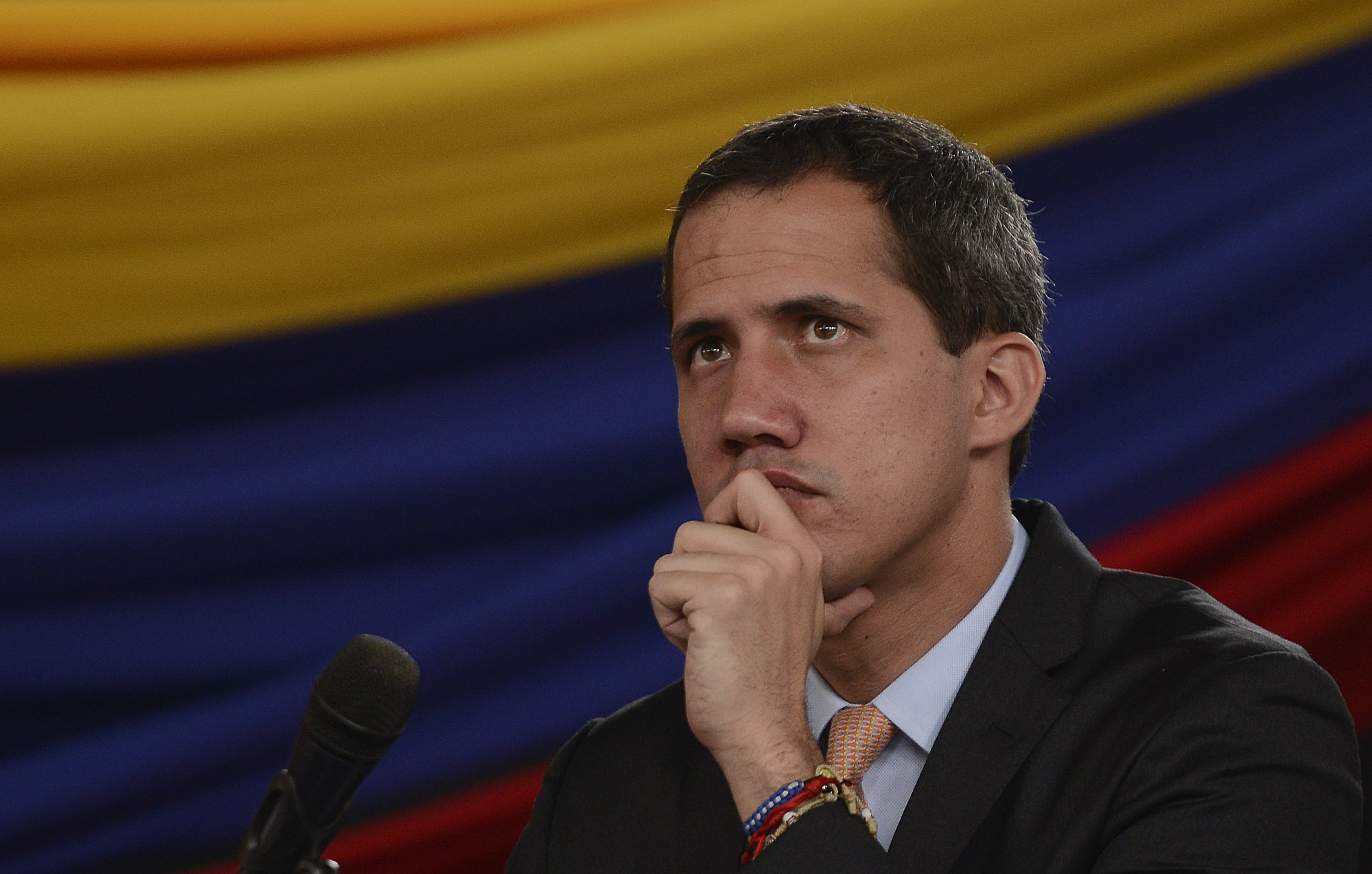 Opposition leader Juan Guaido holds a session at a theater in the El Hatillo neighborhood after opposition lawmakers' vehicles were attacked by government supporters while driving to the National Assembly in downtown Caracas, Venezuela, Wednesday, Jan. 15, 2020. It's the second time this month that lawmakers have been barred from from the building that houses the only branch of government out of control of President Nicolas Maduro's government. (AP Photo/Matias Delacroix)