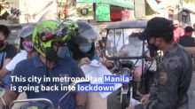 Philippines city goes into lockdown as virus cases surge