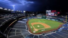 Cole, Stanton lead Yanks past Nats 4-1 in stormy MLB opener