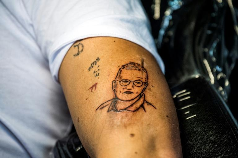 """Agerblad shows off his new tattoo which he wanted as he saw the coronavirus as """"a part of my life, for the rest of my life"""" (AFP Photo/Jonathan NACKSTRAND)"""