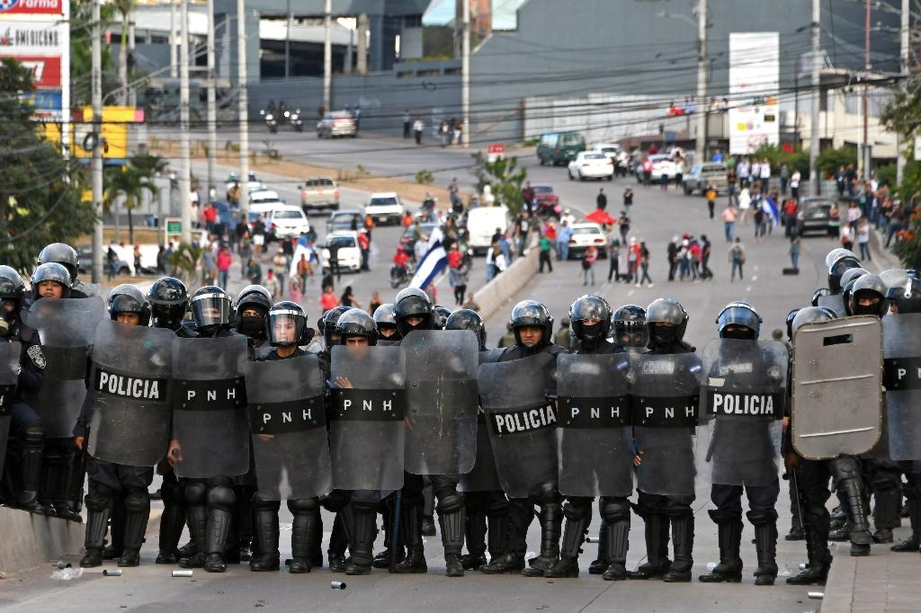 Honduran Opposition Alliance Against the Dictatorship supporters clash with army soldiers and riot police agents protesting against president Juan Orlando Hernandez reelection